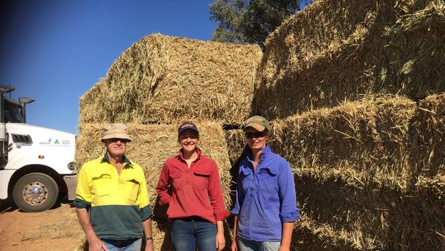 Three generations of farmers collecting Rural Aid bale relief in Yeoval, NSW. From left, Trevor Tremain, granddaughter Darby Tremain and daughter-in-law Nicole Tremain. Picture: supplied