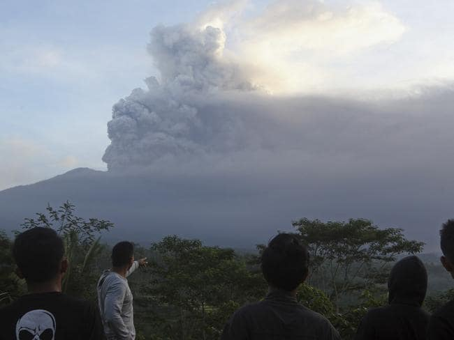 Villagers watched Mount Agung as it erupted. Picture: AP