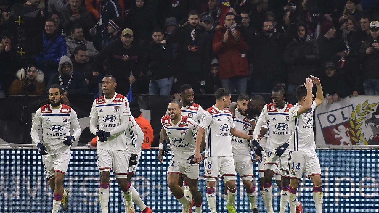 Lyon's French forward Nabil Fekir (C-R) jubilates with teammates after scoring a goal
