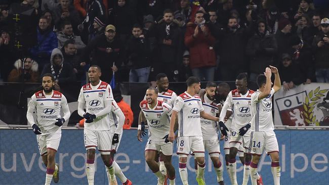 Lyon's French forward Nabil Fekir (C-R) jubilates with teammates after scoring a goal