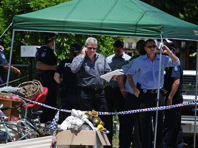 Police say it may take several days for forensic specialists to collect evidence from the house.