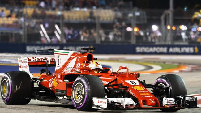 Ferrari driver Sebastian Vettel drives during the qualifying session for Singapore Grand Prix.