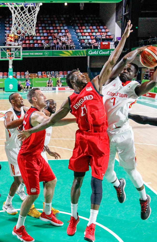 Felix Thierry Bogmis of Cameroon jumps for a shot at the hoop against England at the Townsville Entertainment Centre on April 7, 2018. The basketball team have reportedly flown home to Cameroon. Picture: Michael Chambers