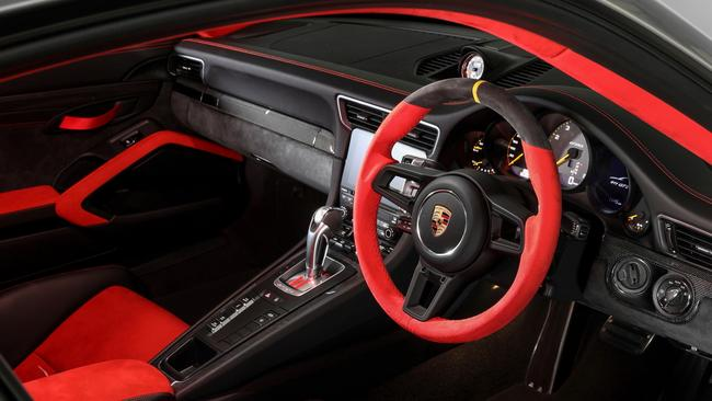 The race-ready interior comes with snug sports seats but the door handles are replaced with fabric, to save weight. Picture: Supplied.