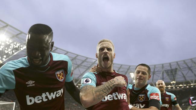 West Ham United's Marko Arnautovic, centre, celebrates scoring