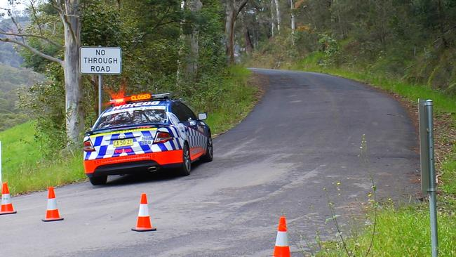 Police off Wisemans Ferry Rd, where Brett's body was found on the morning of October 21, 2014. Picture: David Cleverly