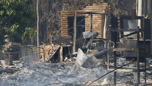 The remains of the residence at Four Paws boarding kennels south of Taree. Picture: AAP