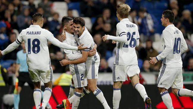 Real Madrid's Enzo Zidane, centre, celebrates after scoring a goal during a Spain's King's Cup soccer match against Cultural Leonesa.s