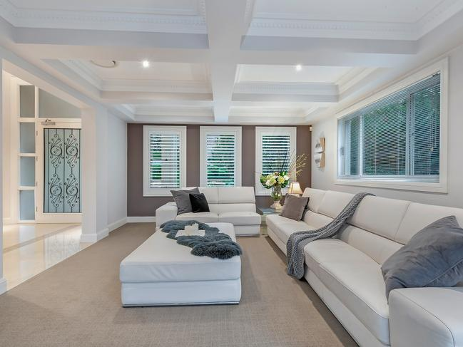 The home features coffered ceilings.
