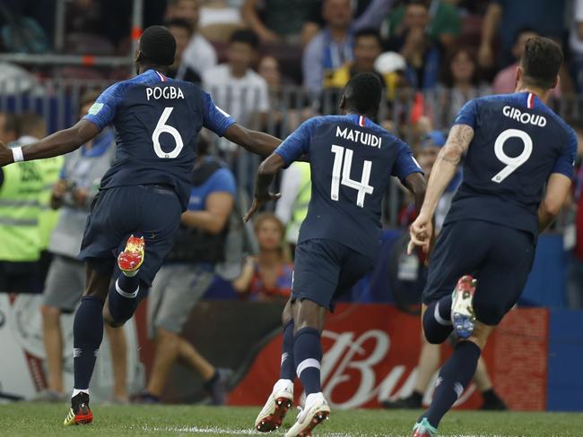 France's Paul Pogba, left, runs as he celebrates scoring his sensational strike. Pic: AP