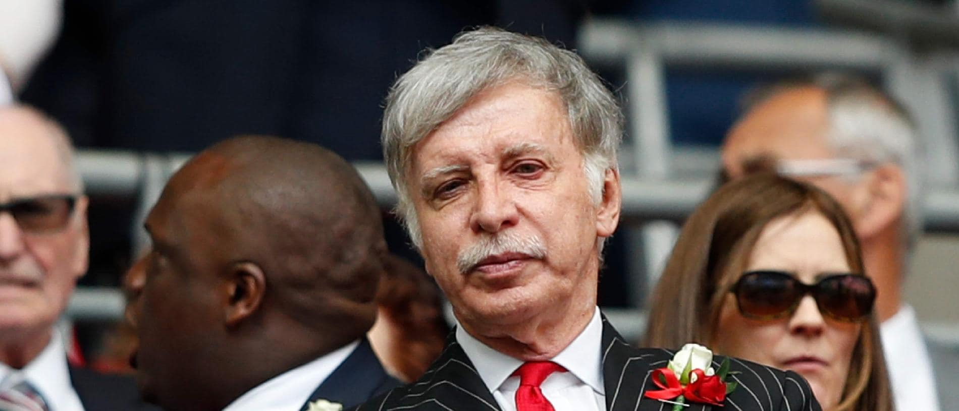(FILES) In this file photo taken on May 27, 2017 Arsenal's US owner Stan Kroenke waits for kick off in the English FA Cup final football match between Arsenal and Chelsea at Wembley stadium in London on May 27, 2017. Arsenal majority shareholder Stan Kroenke on August 7, 2018 announced an offer to buy the entire British football club, valuing it at £1.8 billion ($2.3 billion, 2 billion euros). / AFP PHOTO / Adrian DENNIS / NOT FOR MARKETING OR ADVERTISING USE / RESTRICTED TO EDITORIAL USE