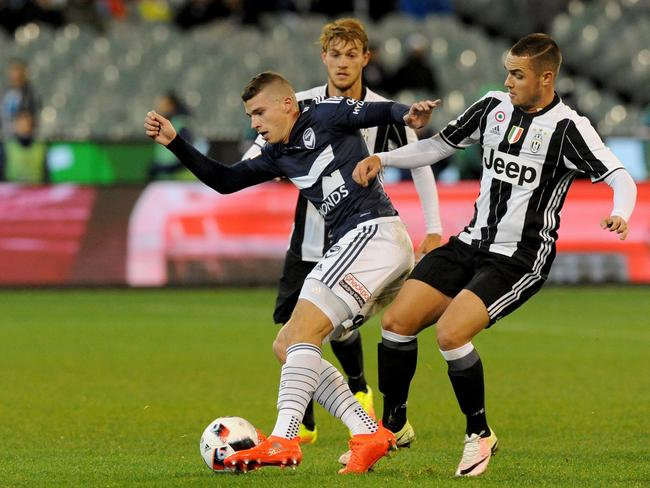 Pol Lirola of Juventus (right) tackles Mitchell Austin.
