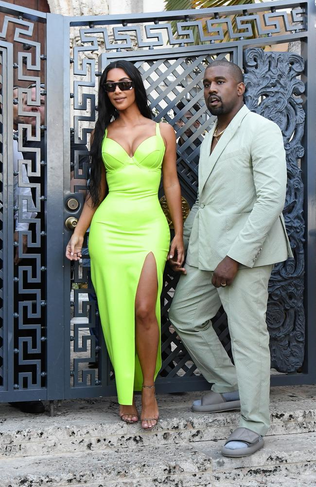 Kim Kardashian and Kanye West made a sartorial statement when they attended a wedding in Miami over the weekend. Picture: Mega