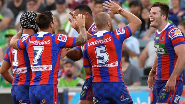 Lachlan Fitzgibbon (right) of the Knights celebrates after scoring a try during the Round 2 NRL match between the Canberra Raiders and the Newcastle Knights at GIO Stadium in Canberra, Sunday, March 18, 2018. (AAP Image/Mick Tsikas) NO ARCHIVING, EDITORIAL USE ONLY
