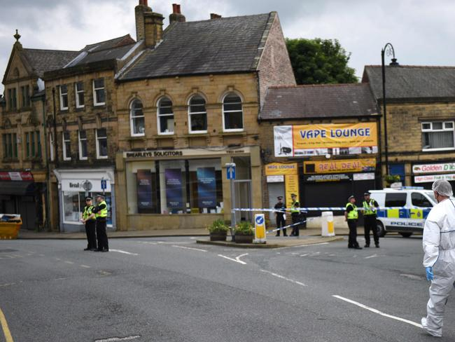 A police forensic officer prepares to work at the scene in Birstall where Labour MP Jo Cox was shot on June 16, 2016. Picture: AFP.