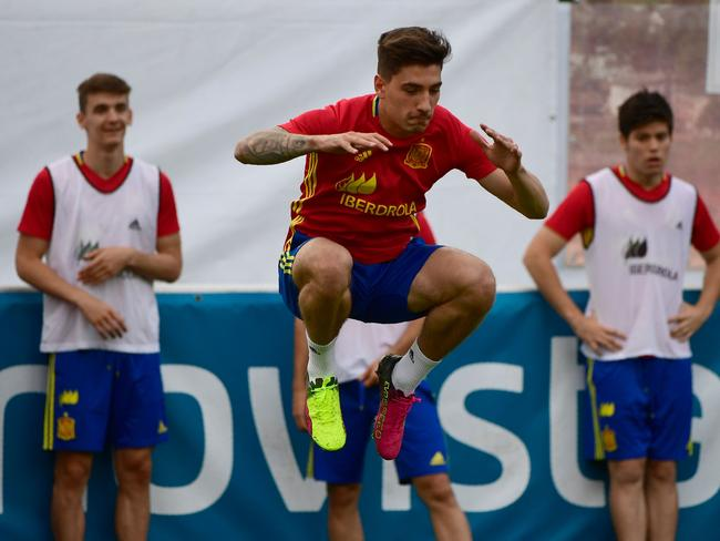 Hector Bellerin jumps during a training session in Schruns, Austria.