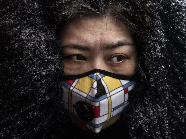 A Chinese woman wears a protective mask in Beijing, China. Picture: Kevin Frayer/Getty Images