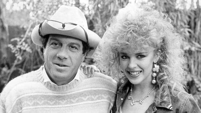 Good mates ... it's 1986 and Molly Meldrum meets Kylie Minogue and her uber-perm at his Richmond house.