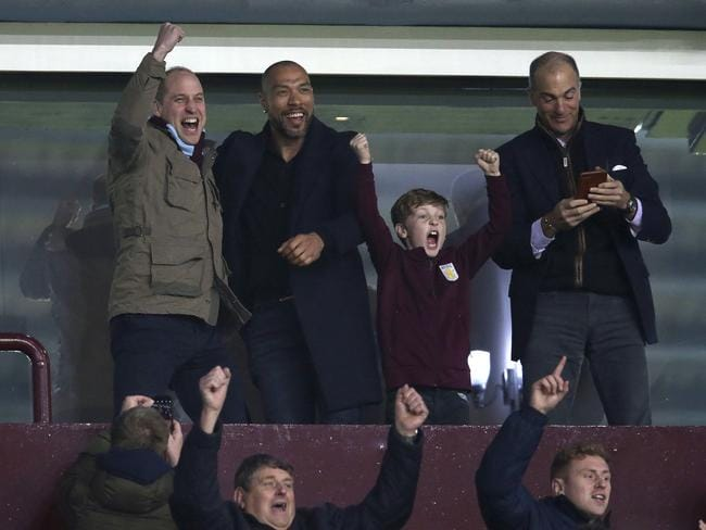 Britain's Prince William, left, and former Norwegian international soccer player John Carew, second left, celebrate after Aston Villa's Jack Grealish scored his side's first goal