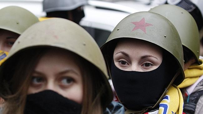 Women's movement... Female protesters demand a stop to the prosecutions of anti-government activists. Picture: Yuri Kinichny/AFP