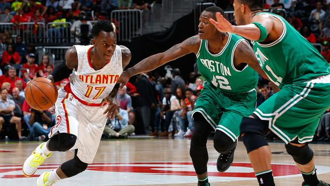 Dennis Schroder of the Atlanta Hawks drives against Terry Rozier and Evan Turner of the Boston Celtics in Game Two.