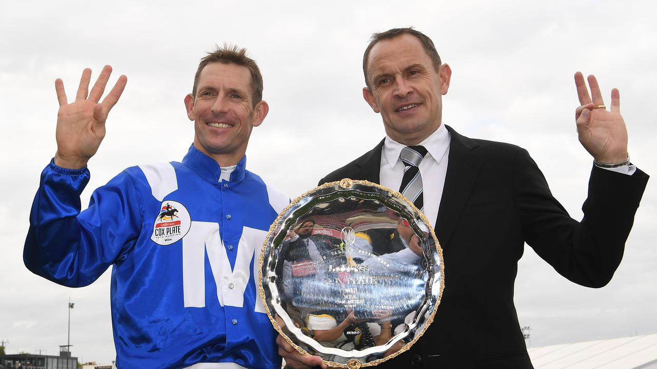 Hugh Bowman and trainer Chris Waller with the Cox Plate after Bowman rode Winx to victory for the fourth time in 2018