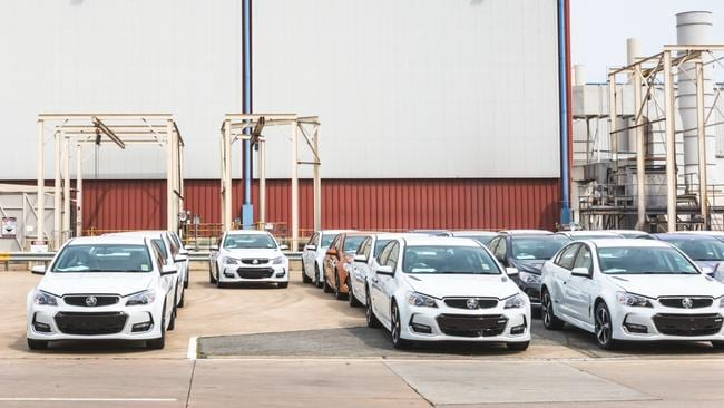 Some of the final batch of Holden Commodores ready to be transported to dealers. Photo: Thomas Wielecki.