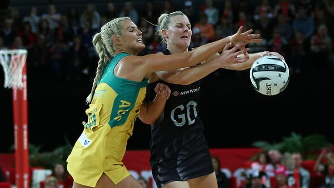 Gretel Tippett clashes with New Zealand captain Katrina Grant.