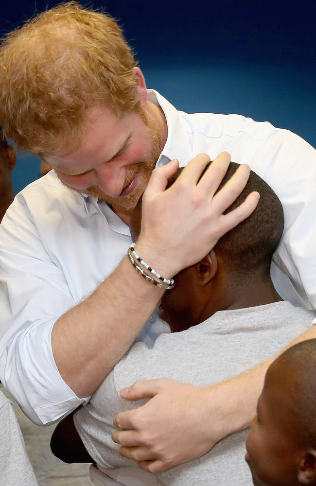 Mutsu and Harry are reunited in 2016 when Mutsu was singing as part of the Basotho Youth Choir in London. Picture: Getty