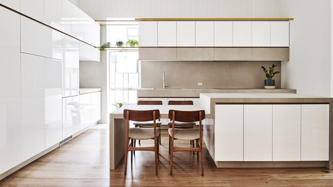 Appliances are concealed behind cabinetry for a clean look.