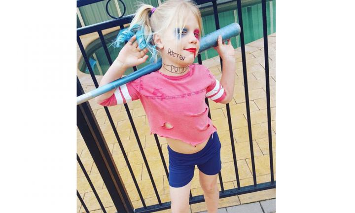 Comic books count right? This mini Harley Quinn is up to date on her pop culture.