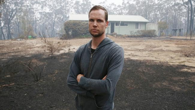 Robin Stone, 33, and his family had to flee their rented home in Wingello near Bundanoon and are staying in Moss Vale. He returned to collect belongings after firefighters saved the home. Picture: David Swift
