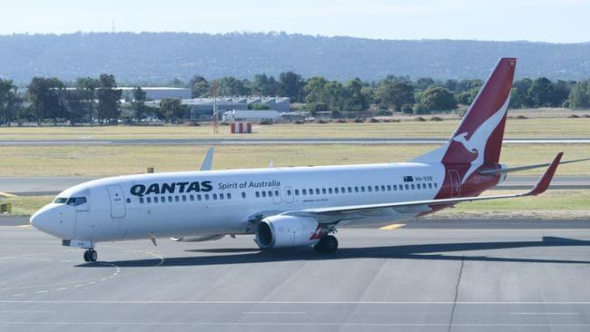A drunk flight passenger who threatened Qantas staff has been fined $25,000.