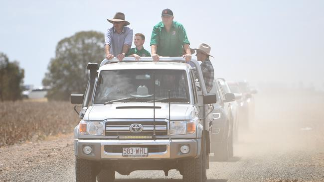Prime Minister Scott Morrison (right) and Agriculture Minister David Littleproud visit a drought-affected property near Dalby, Queensland to announce a new drought support package of nearly $100 million. Picture: Dan Peled/AAP