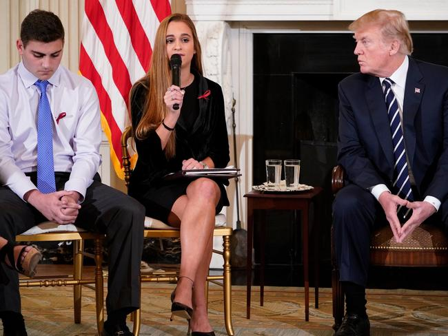 """Trump watches as Julia Cordover, Parkland student body president, speaks during a """"listening session"""" on gun violence in the State Dining Room of the White House. Picture: AFP/Mandel Ngan"""