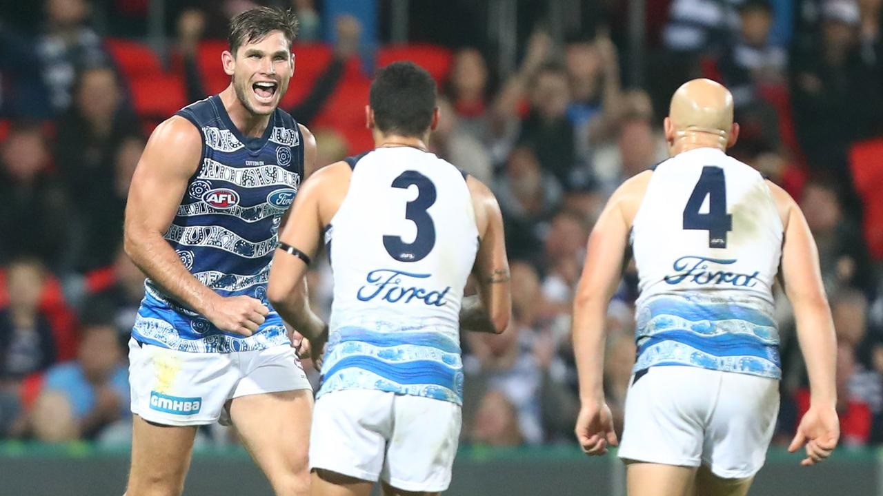 Geelong Cats defeat Gold Coast Suns in Round 10: Suns challenge ladder leaders but Cats pull away late