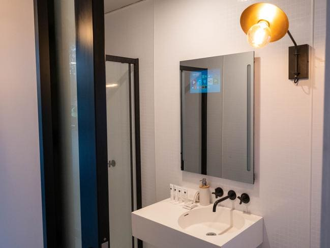 The bathroom has its own 'Smart Mirror' powered by a phone.