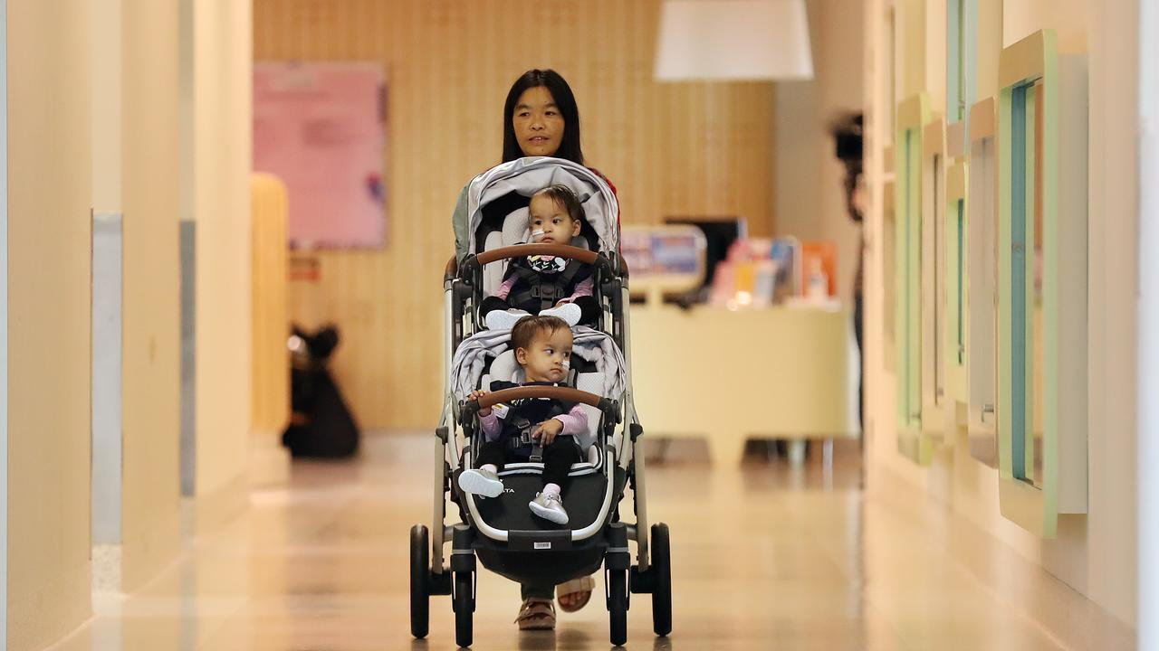 Mum Bhumchu Zangmo leaves the Royal Children's Hospital in Melbourne with the twins Dawa (top) and Nima (bottom). Picture: Alex Coppel
