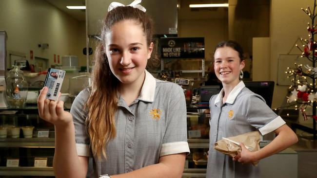 Wilderness school students Isabel and Annabel. Their school is implementing a cashless payment system for their cafe. Picture: Calum Robertson