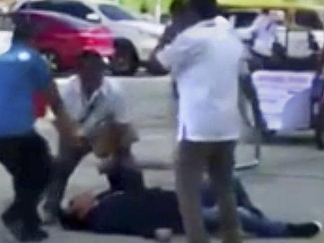 Video grab showing Philippines Mayor Antonio Halili on the ground after being shot during a flag-raising ceremony on Monday, July 2, 2018 south of Manila. Picture: AP Photo
