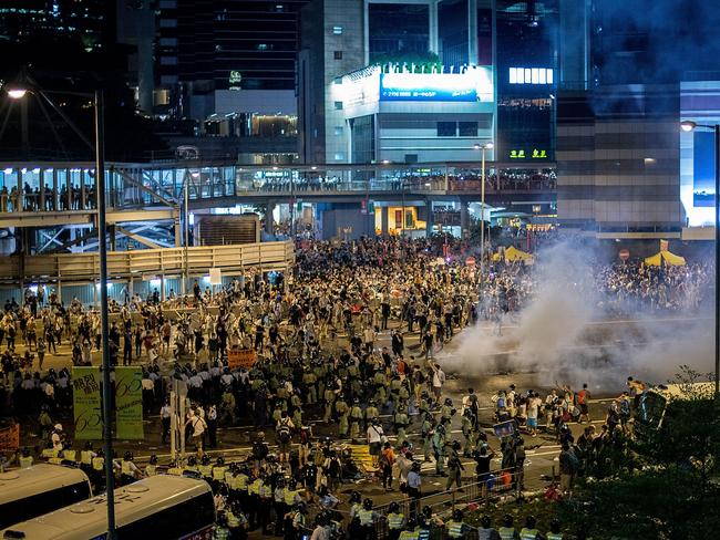 Defiant ... police lobbed canisters of tear gas into the crowd on Sunday evening. Picture: Getty