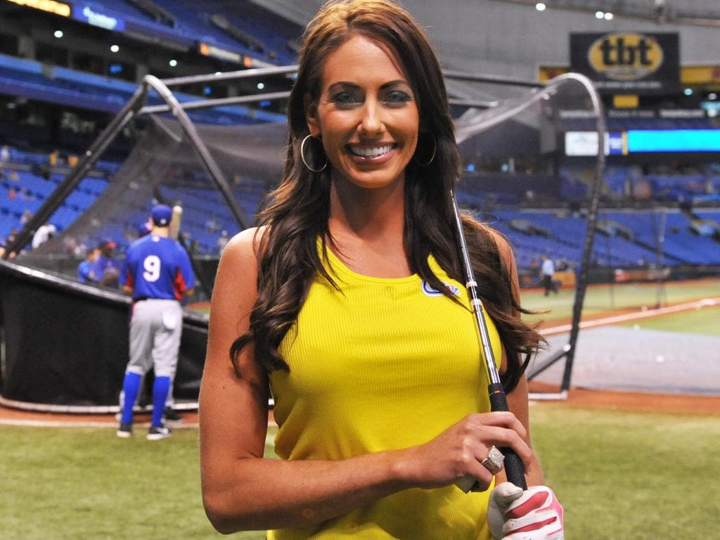 ST. PETERSBURG, FL - SEPTEMBER 16: Golfer Holly Sonders poses before throwing out a ceremonial first pitch as the Tampa Bay Rays host the Texas Rangers September 16, 2013 at Tropicana Field in St. Petersburg, Florida. Sonders is co-host of the Gold Channel's Morning Drive. (Photo by Al Messerschmidt/Getty Images)