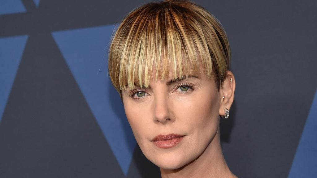 Theron says living with her father's 'disease' as a child often filled with her fear. Picture: AFP.