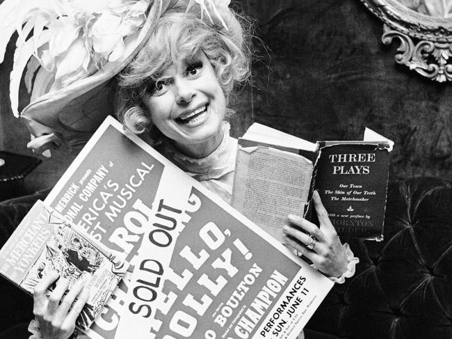 Carol Channing holds a sold out advertisement poster of Hello, Dolly in Houston in 1967. Picture: AP