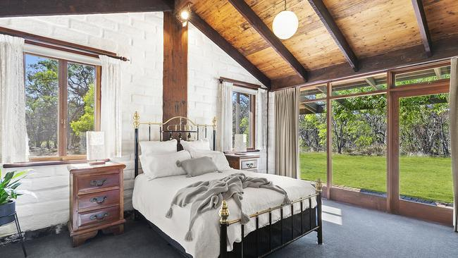 High timber-lined ceilings add character.