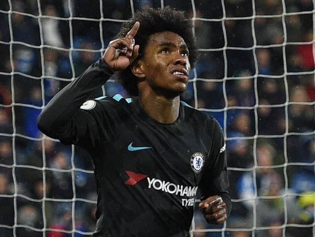 Willian celebrates. / AFP PHOTO / Oli SCARFF