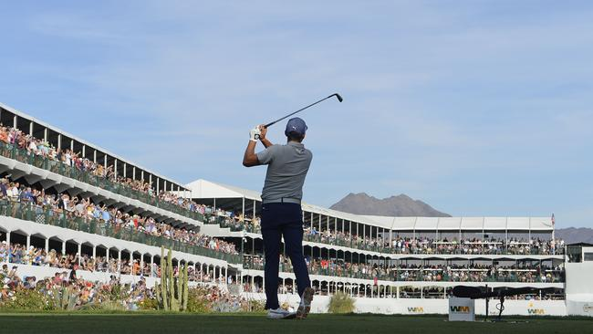 Rickie Fowler hits his tee shot on the 16th hole.