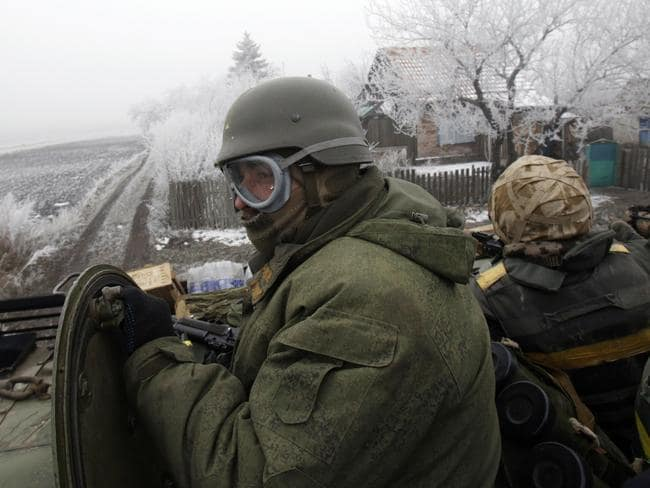 Reinforcements ... A convoy of Ukrainian forces drives to Debaltseve at the weekend. Reports are that the Ukrainian forces within that city have now been surrounded. Source: AFP