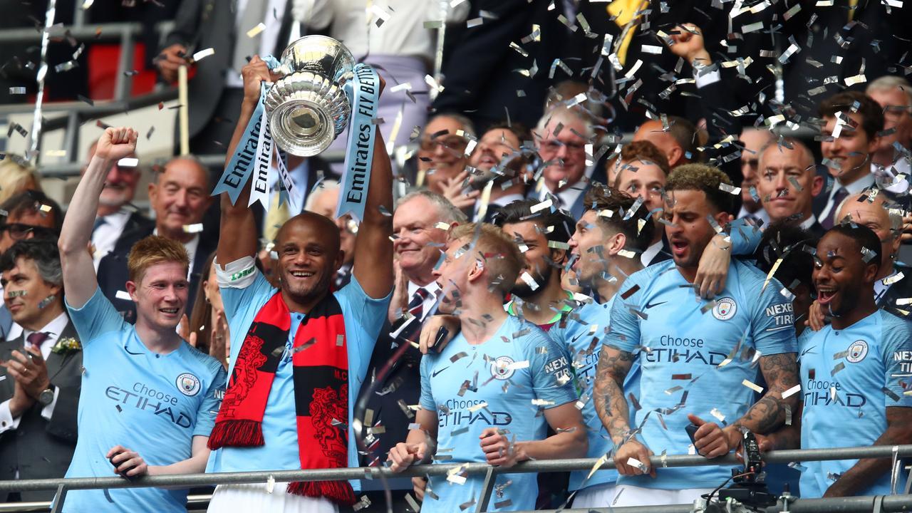 Vincent Kompany lifts the trophy at Wembley