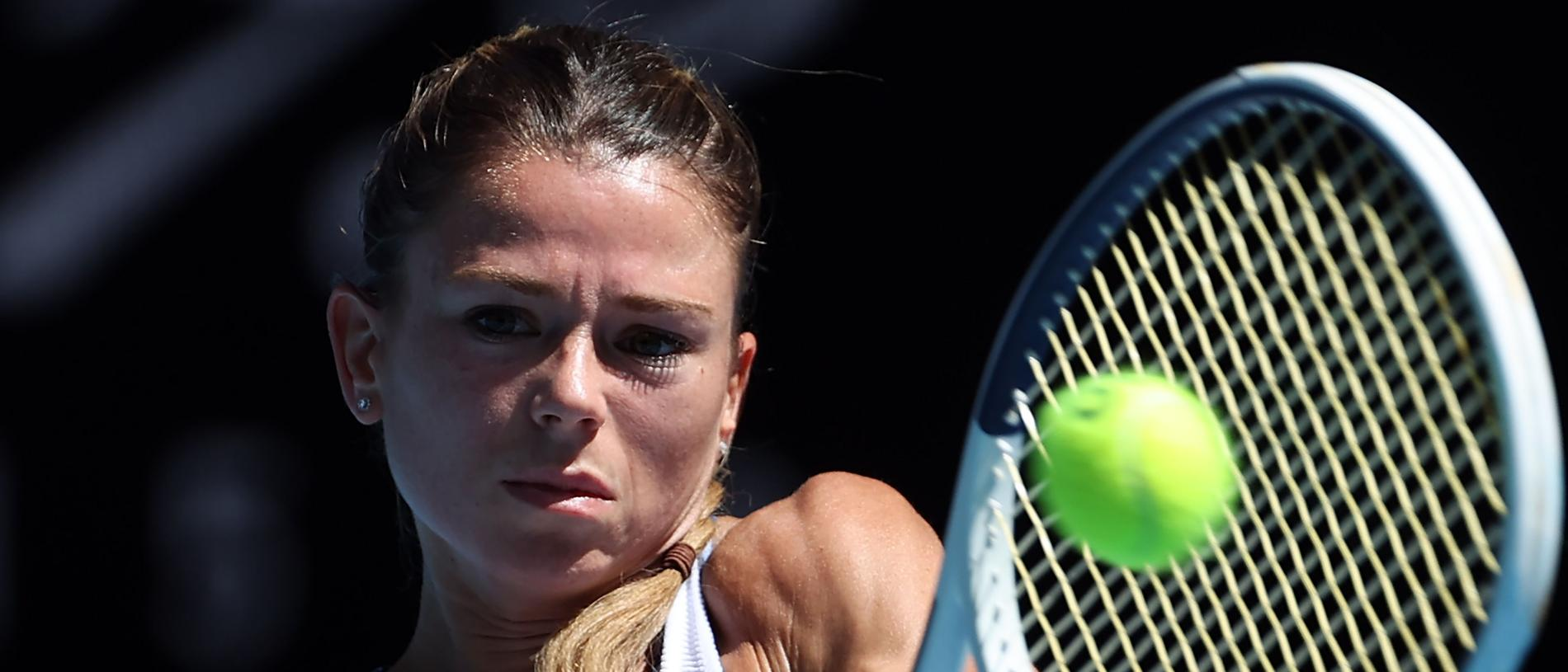 Italy's Camila Giorgi hits a return against Germany's Angelique Kerber during their women's singles match on day six of the Australian Open tennis tournament in Melbourne on January 25, 2020. (Photo by DAVID GRAY / AFP) / IMAGE RESTRICTED TO EDITORIAL USE - STRICTLY NO COMMERCIAL USE